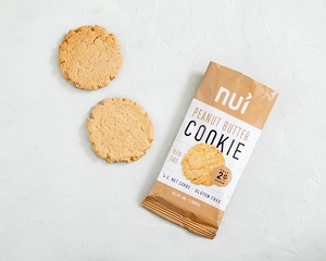 two peanut butter cookies on a table from nui after purchasing with a discount code